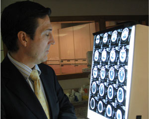 Dr. Vanaclocha reviewing a case of brain tumour
